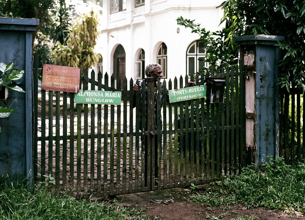 Man at gate in Fort Kochi.