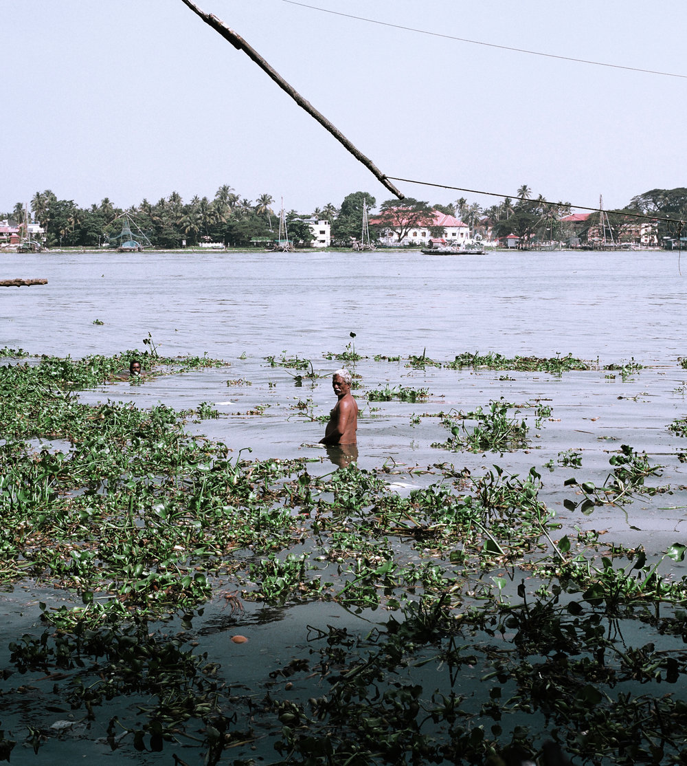 Man bathing in Fort Kochi.