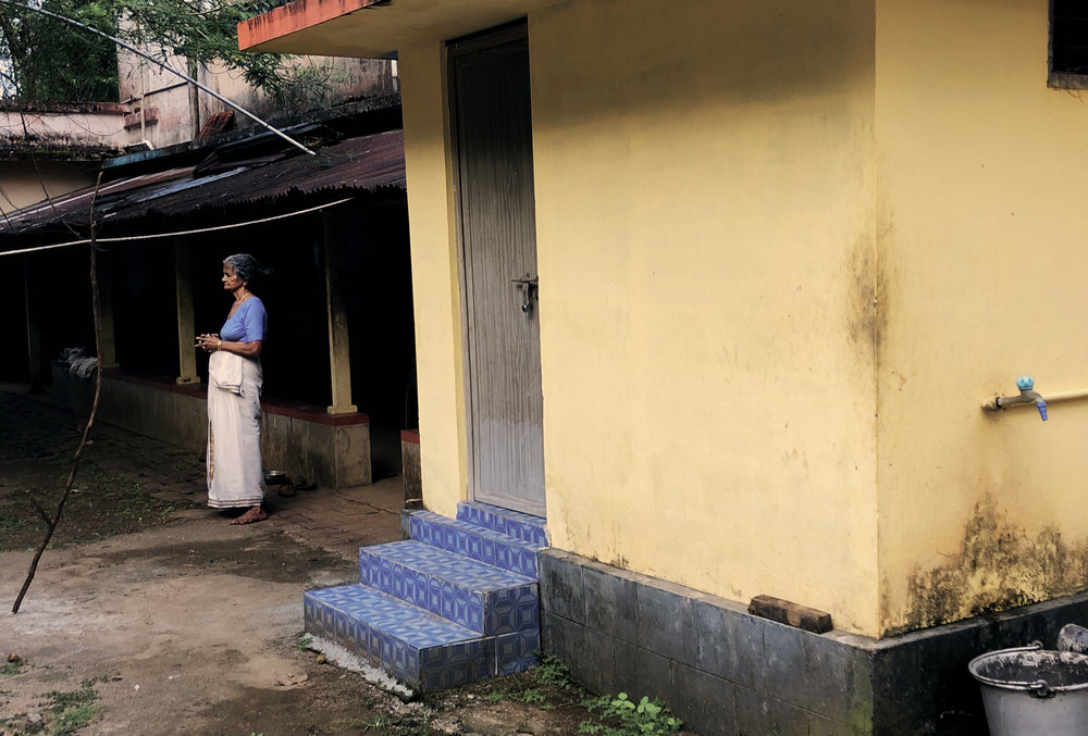 Woman outside her home in Thrissur.