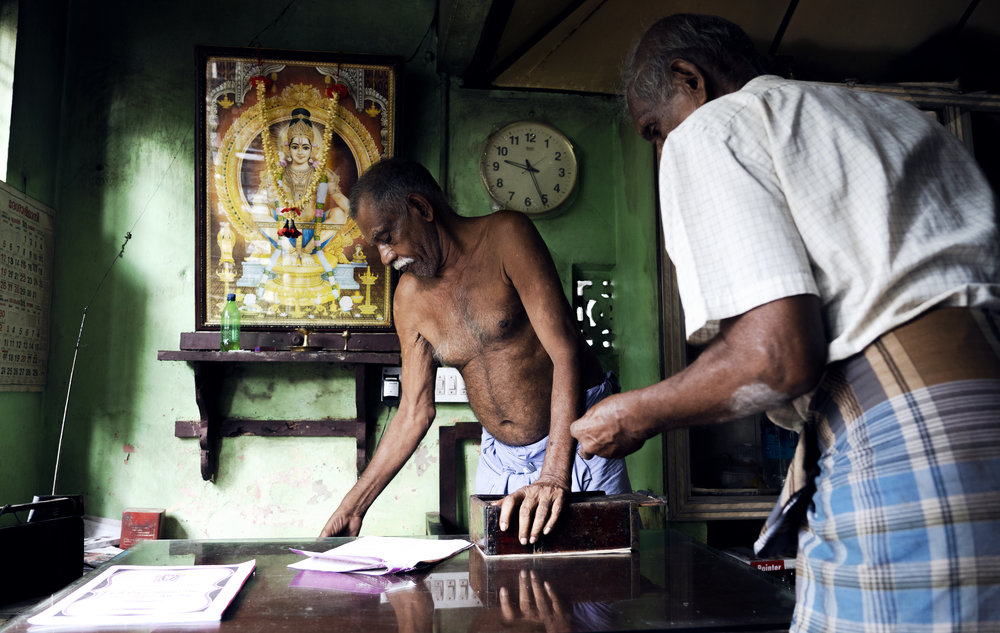 Man paying for his meal at backwaters restaurant.
