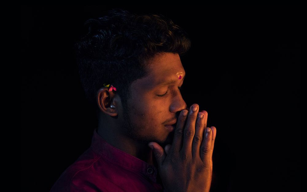 Man praying at hindu ceremony in Thrissur.