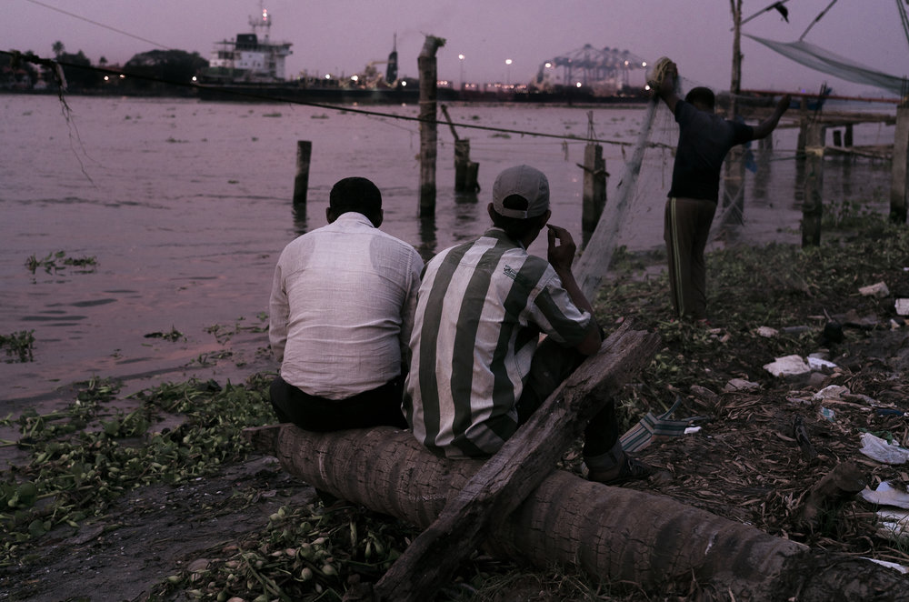 Fishermen at dusk in Fort Kochi.