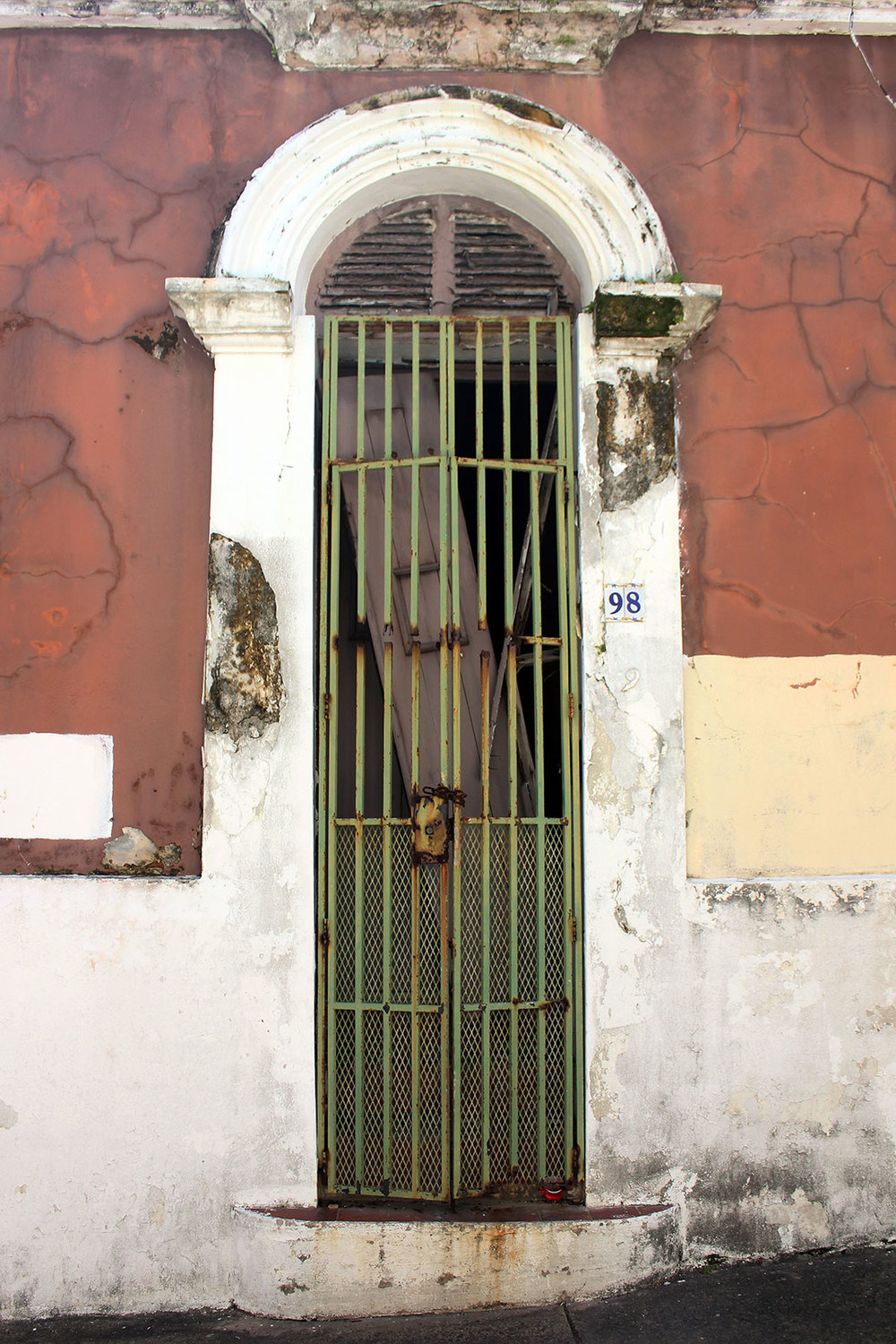 While there were many lavish and new buildings, I really gravitated toward the rusty ironwork of these more dilapidated doors and entryways.