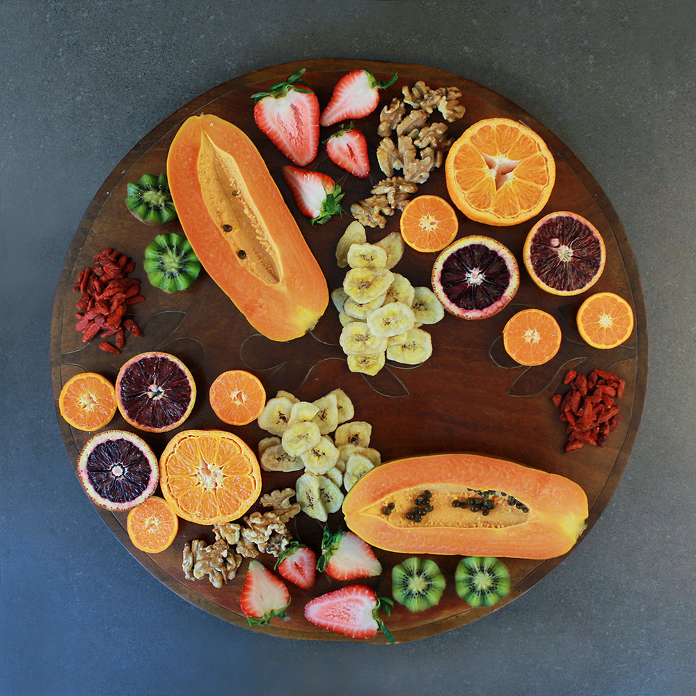 Fill in all the gaps with the smallest ingredients, such as nuts and dried fruit. Don't be shy about really filling up the platter!