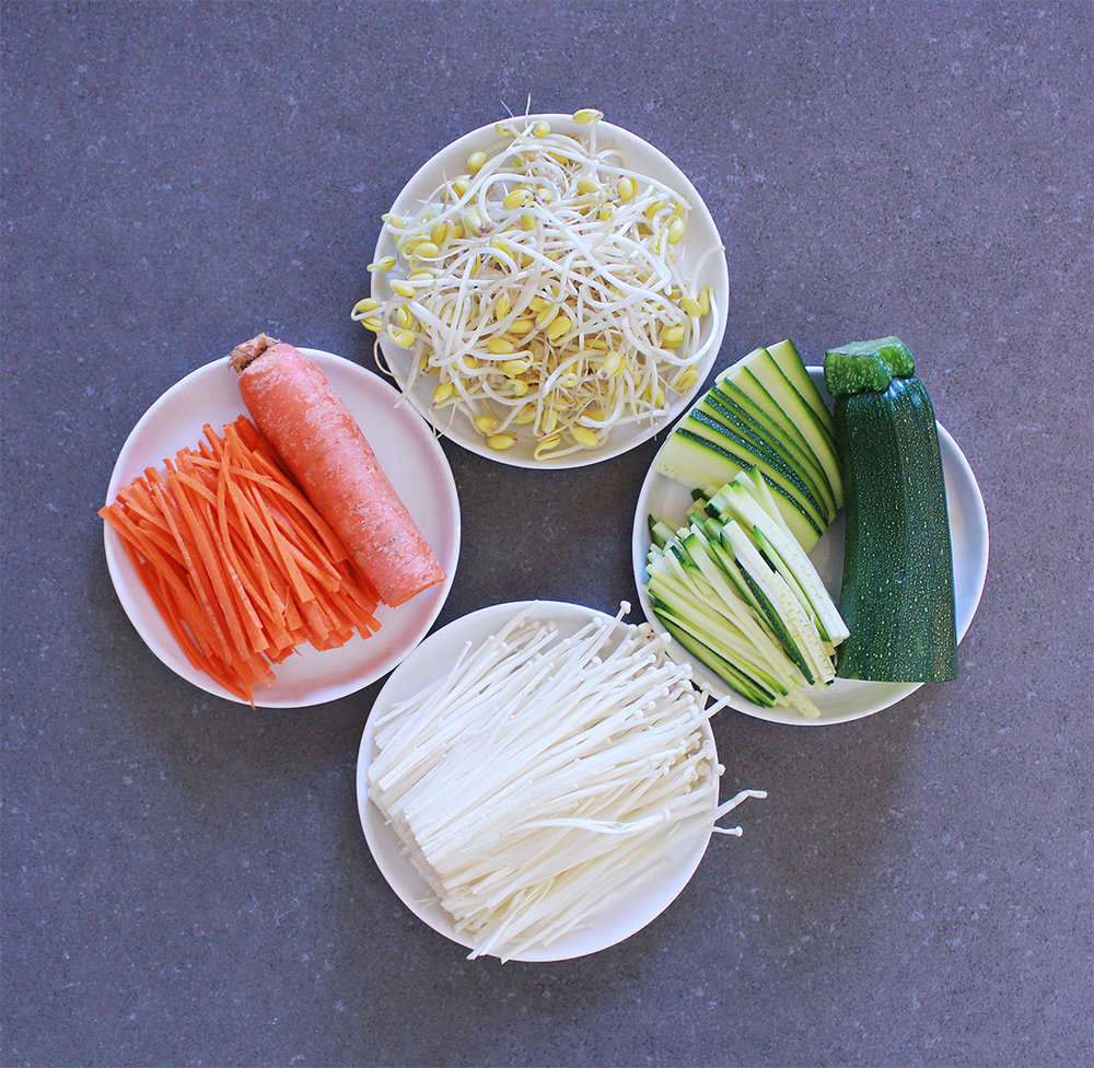 Then prep the ingredients to be cooked. Prep the carrots, zucchini, enoki mushrooms, and bean sprouts. Lightly salt and sautee the carrots, zucchini, and mushrooms, and lightly blanch the bean sprouts in boiling water.