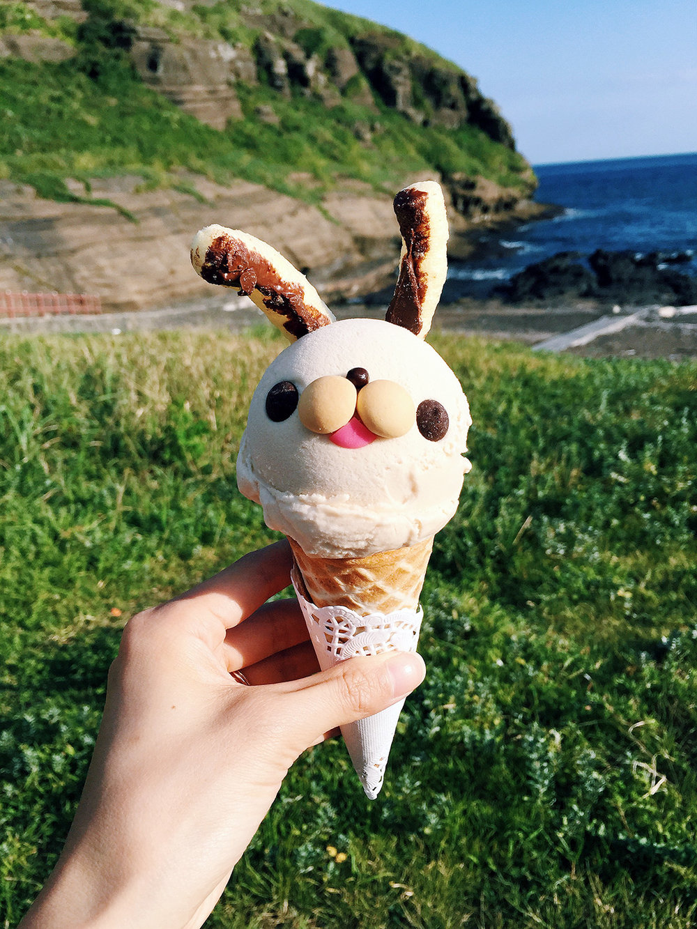 "Enjoying the cutest, hazelnut ""bunny"" ice cream from Chi Chi Pong while enjoying the views of Yongmeori coast. This is vacation at its best! Information: Chi Chi Pong Yongmeori Coast"