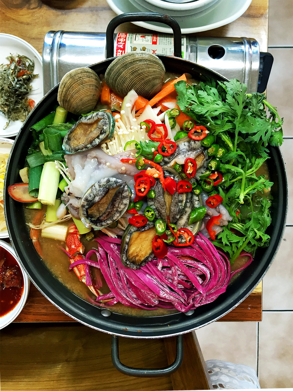 The freshest seafood hot pot with purple cactus infused noodles, octopus, crab, abalone, clams, and much more from Hanseong Restaurant (한성식당). Address: 202-1 Seongsan-ri, Seongsan-eup, Seogwipo-si, Jeju-do, South Korea Info: Here