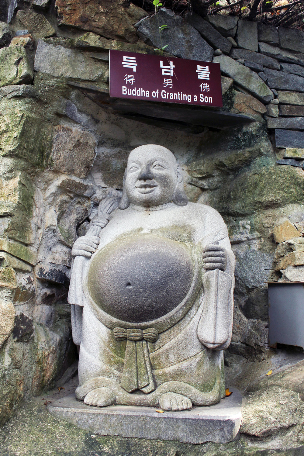 Rubbing this Buddha's belly while praying is said to grant sons to expectant mothers.