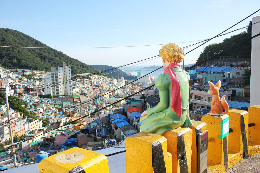 Views from the top of Gamcheon Culture Village are a rainbow of color, leading your eyes all the way to the ocean.