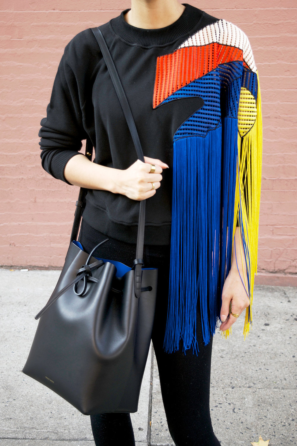 Christopher Kane fringe sweater, Mansur Gavriel black bucket bag