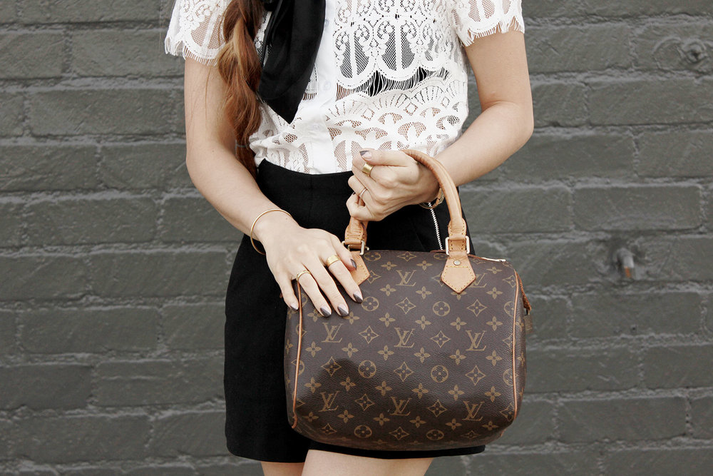 Nasty Gal lace blouse, Zara high-waisted shorts, and Louis Vuitton Speedy bag