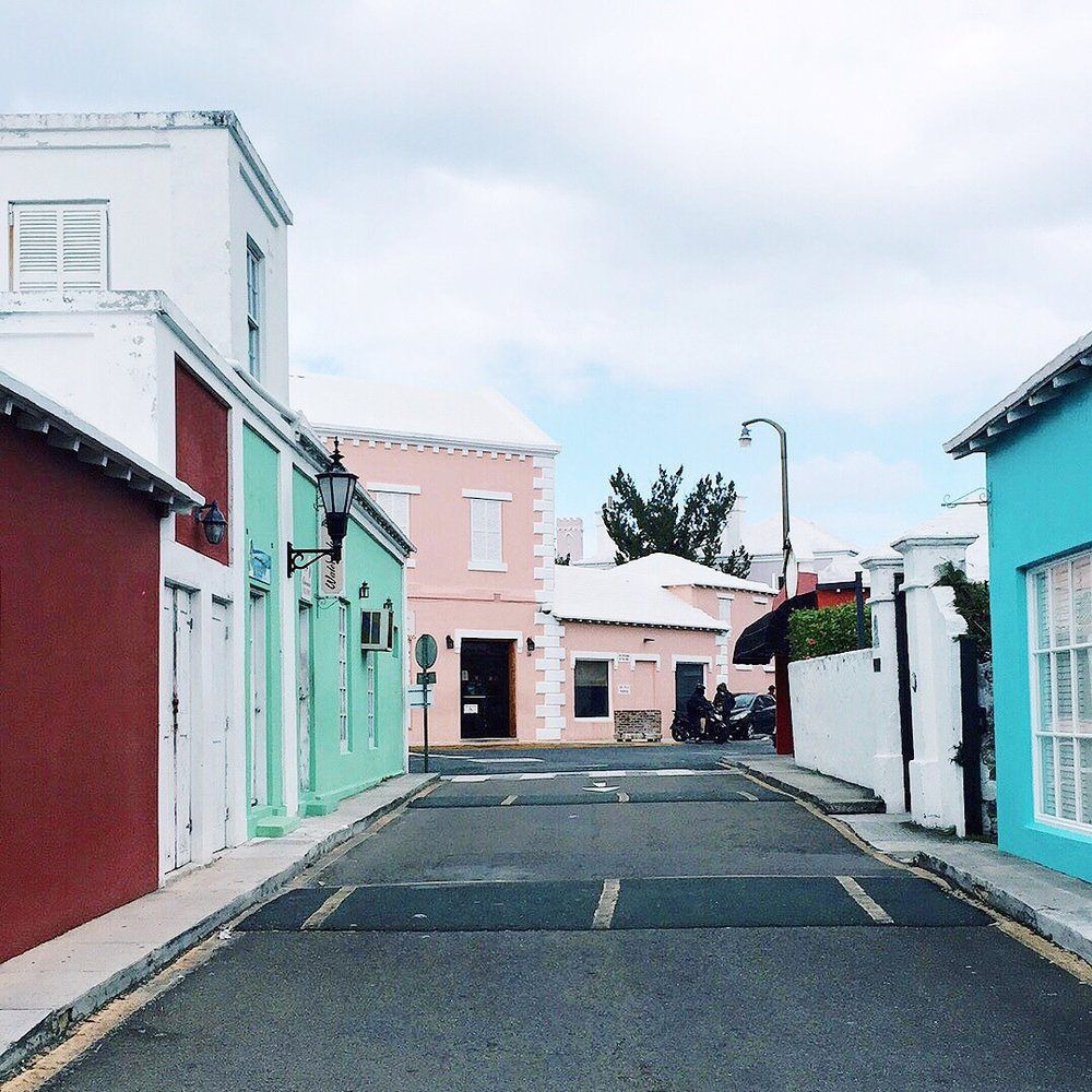 Colonial style pastel buildings around central King's Square in St. Georges.