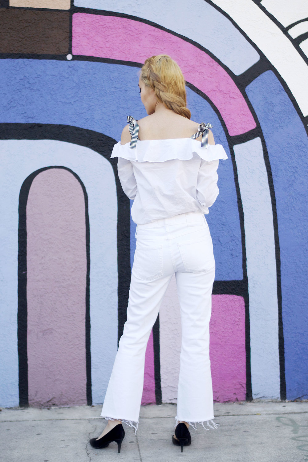 I don't follow fashion rules such as no white until after Memorial Day, so here I am in a white on white look showing you how to wear all white in spring! I love a monochrome look because the minimalist aesthetic is instantly elongating, simple yet fresh, and always chic. My all white look is so simple: pair a cute white blouse/top with a great-fitting pair of white denim. | SPRING FASHION | AMO JEANS | ALL WHITE OUTFIT | SPRING OUTFIT IDEAS | WHITE JEANS | OFF THE SHOULDER TOP | TIE SHOULDER |