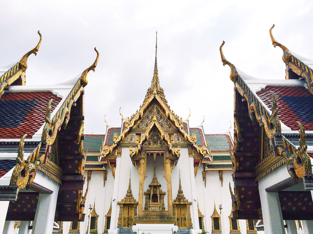 A view of Phra Thinang Dusit Maha Prasat at the Grand Palace. The ornate rooftops and tile work is so gorgeous!