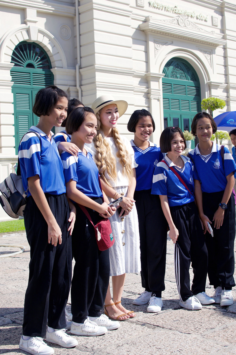 These Thai students were on a school field trip to Wat Phra Kaew and stopped me several times asking if they could take photos with me. How cute are their innocent faces and matching school uniforms?! I was flattered they wanted to take pictures with me, and also very embarassed and shy, lol! Jack snapped a photo of the crew taking a group photo with me.