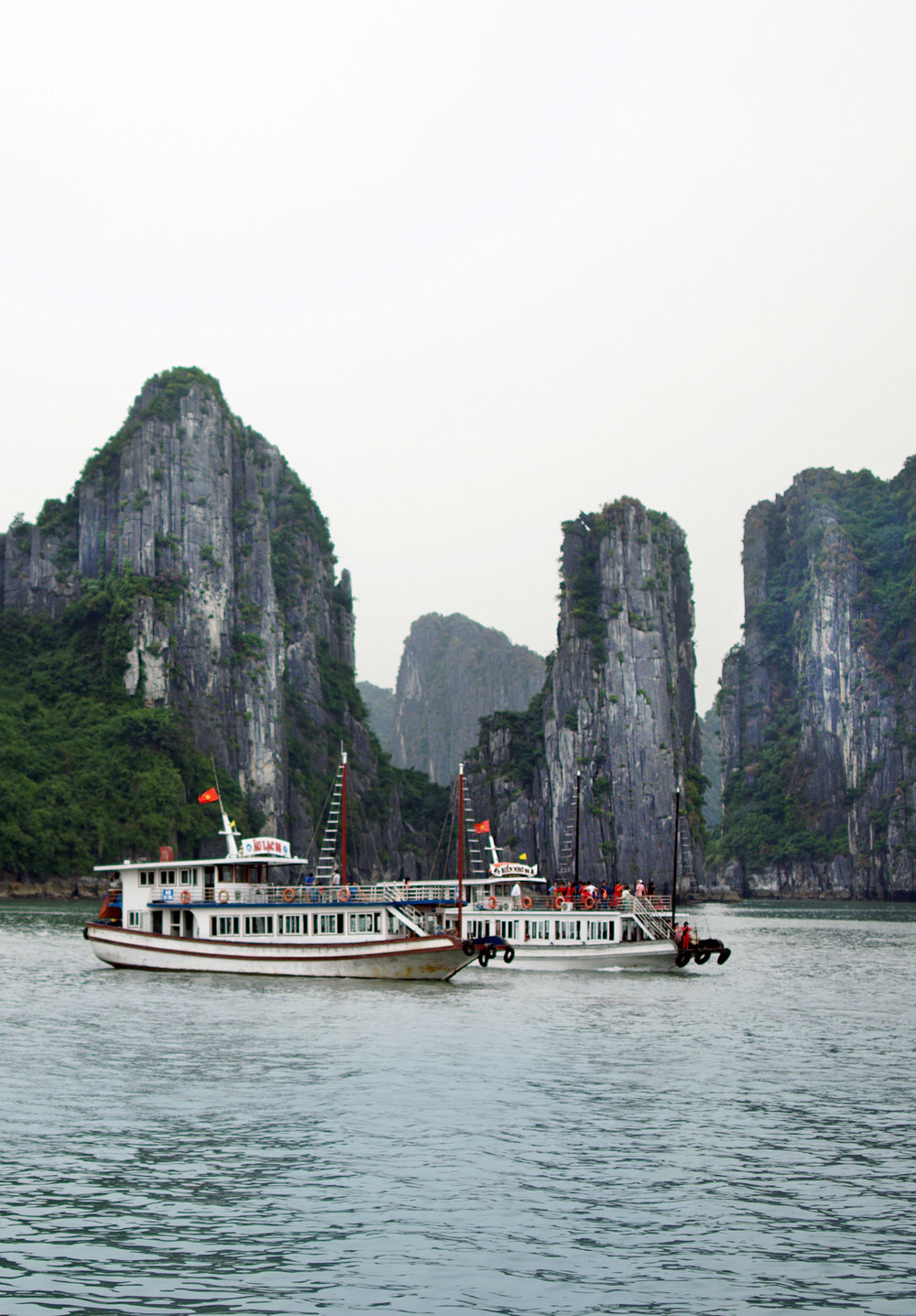 HALONG BAY CRUISE  Whether you book a day trip, or a cruise boat, you're going to want see the limestone islets as close as possible. The tranquil views are really unforgettable!