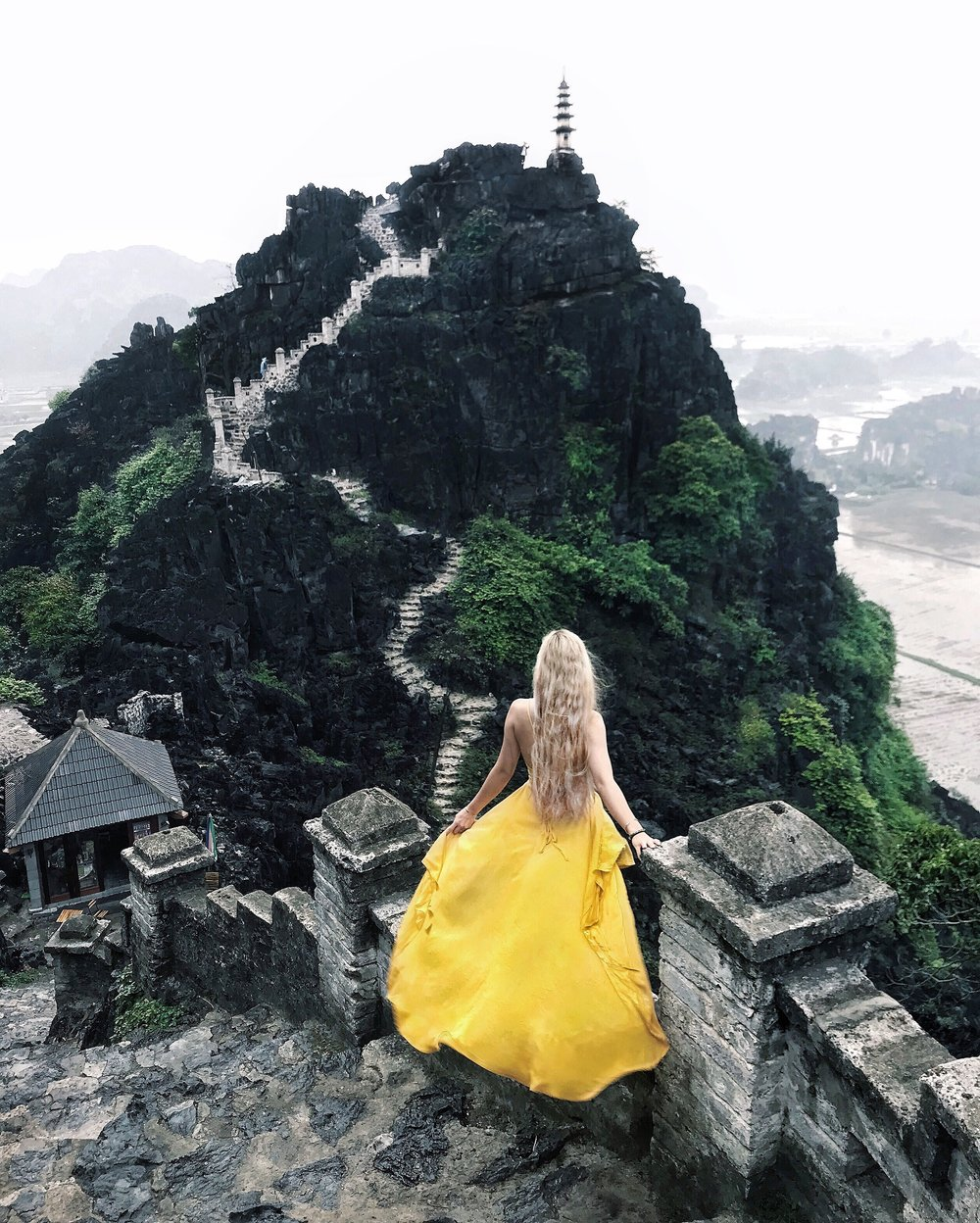 HANG MUA/MUA CAVES  We climbed 500 stone steps in the pouring rain to see this gorgeous view from the top of Hang Mua! It takes less than 30 minutes to reach the summit, and the mountain and river views are so breathtaking! It was one of my favorite spots in Ninh Binh!