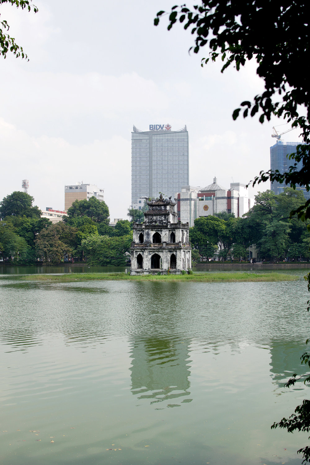 HOAN KIEM LAKE  Hoan Kiem Lake feels like a serene oasis in the bustling Old Quarter. The lake surrounds Ngoc Son Temple, which was built in the 18th century. If you go early in the morning, you can see locals doing yoga and Tai Chi!