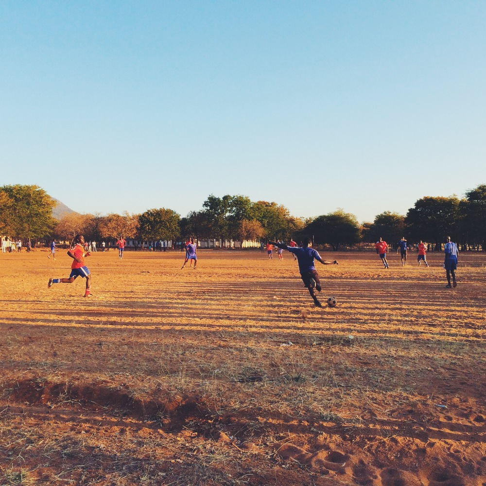 First round community football game at Chaseyama in the evening sun