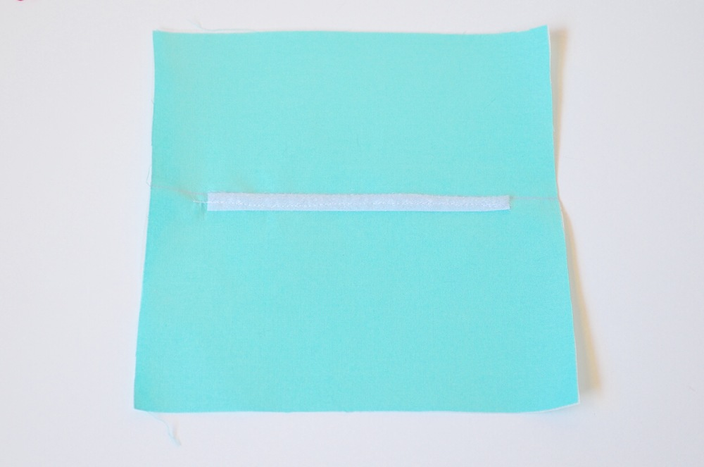 9. Place hook tape just below the line, centering it, pin or tape and sew the length of the tape.