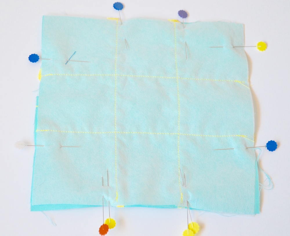 """11. Lay the 6-3/4"""" x 6-3/4"""" layer with the rick rack attached to it on top with WRONG side facing up. Pin all the way around leaving a 2-3"""" opening....mark the opening with 2 pins. Sew all the way around leaving a 2-3"""" opening. Trim corners. Turn right side out."""