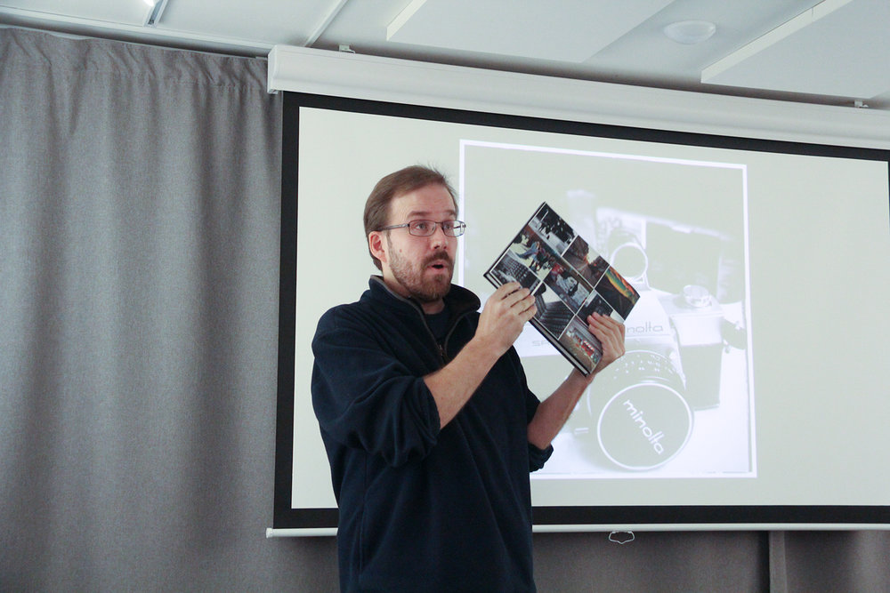 Me talking about the Blurb book I made of the project at my photo club. Photo by Ulf NIlsson