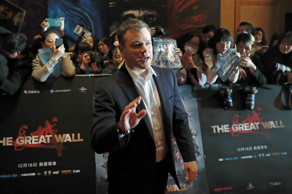 "Actor Matt Damon gestures in front of Chinese fans as he arrives at a red carpet event for the movie ""The Great Wall"" at a hotel in Beijing, Tuesday, Dec. 6, 2016. (AP Photo/Andy Wong)"