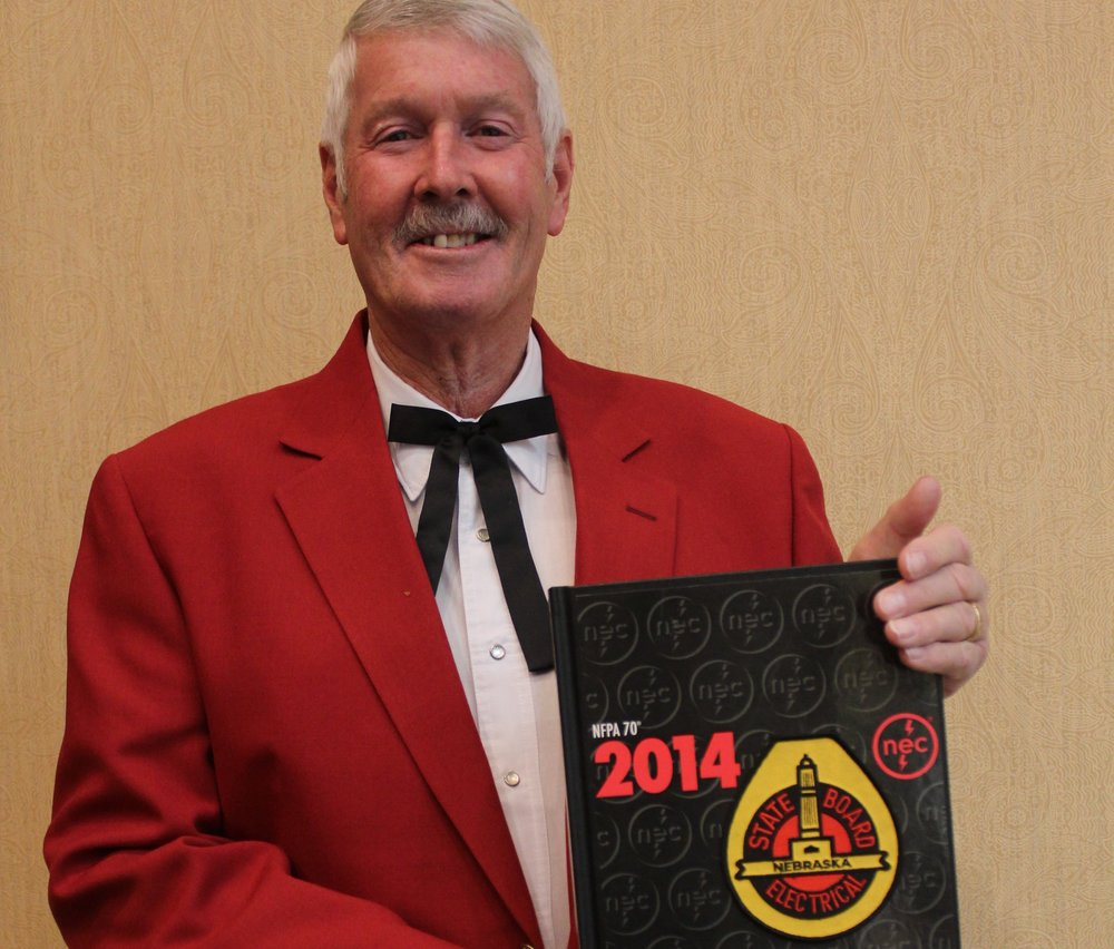 Western Section President Steve Gregory receives his Hard Back 2014 National Electrical Code Book - personalized by the Chapter for him