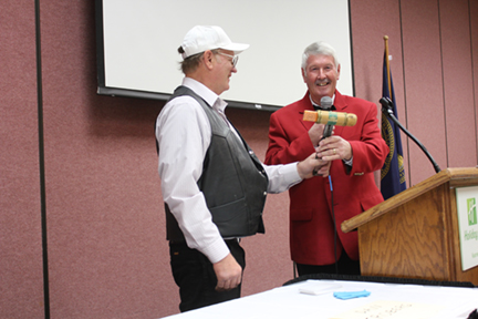 President Mike Robb receiving the Nebraska IAEI Gavel from Western Section President Steve Gregory