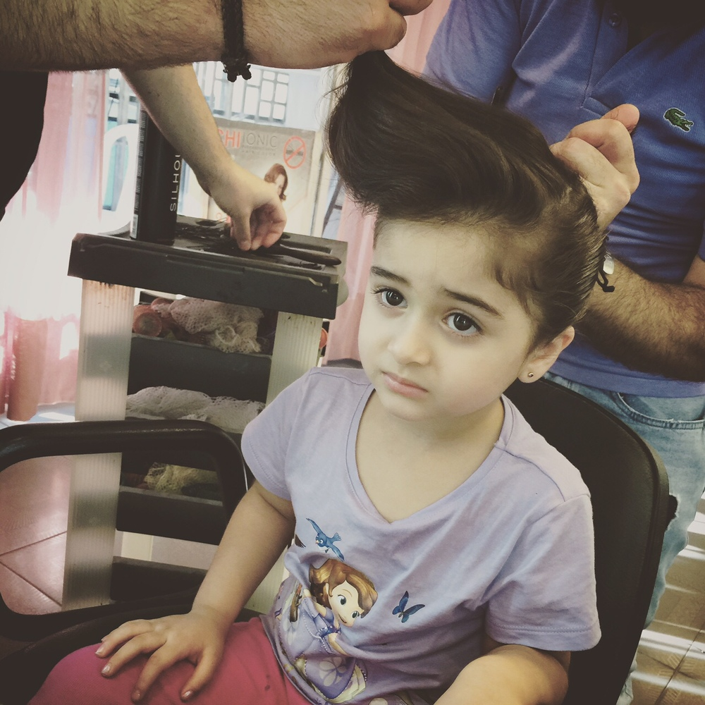 Hani and Lisa's daughter Tulin getting her hair done next to me at the salon. We both felt about the same way about it.