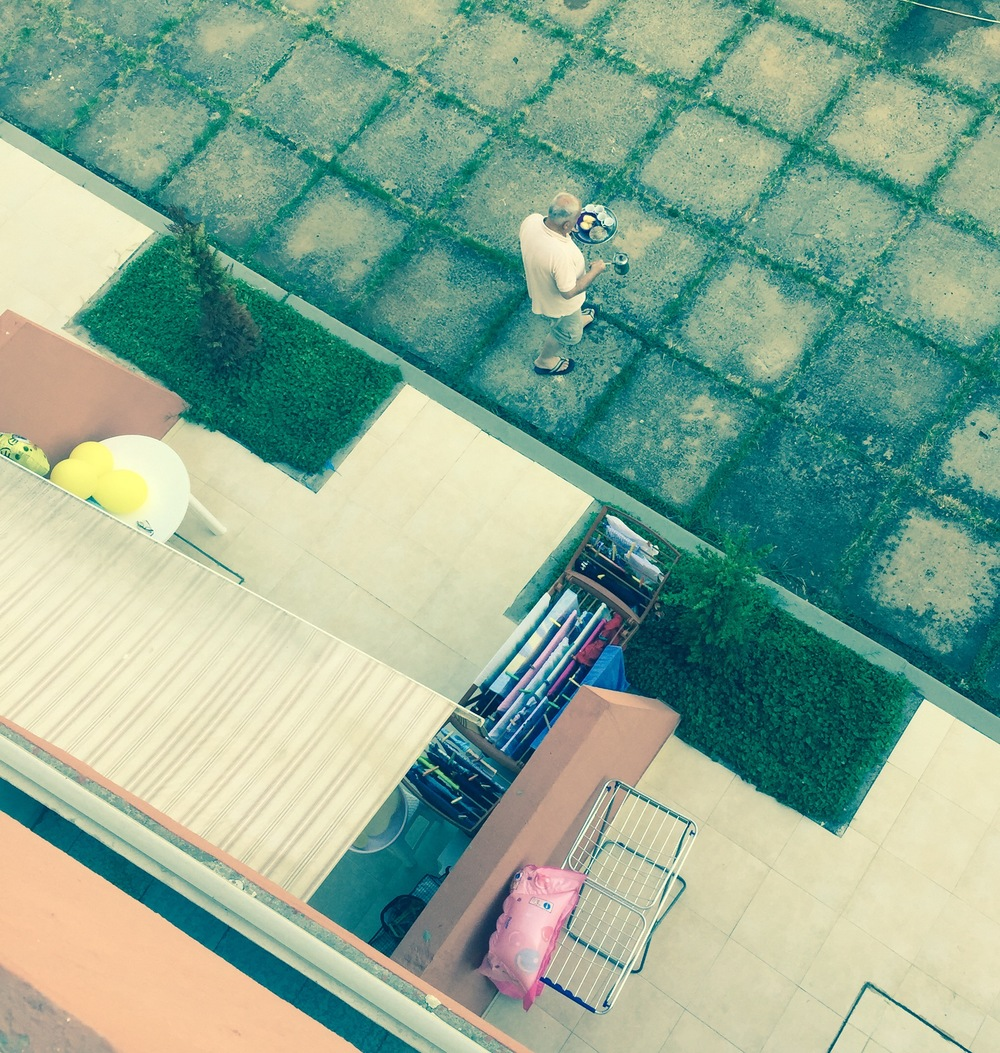 My neighbors enjoyed cut fruit and coffee by the sea every morning. Meanwhile, I creepily took photos from my balcony.