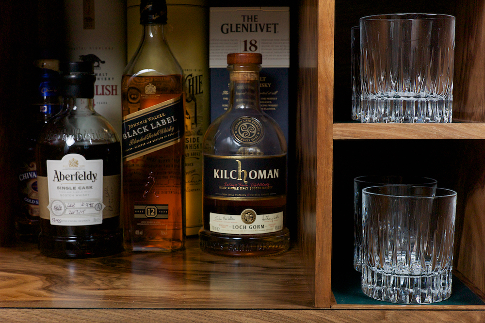 Whisky cabinet glass and bottle detail, Petrel furniture