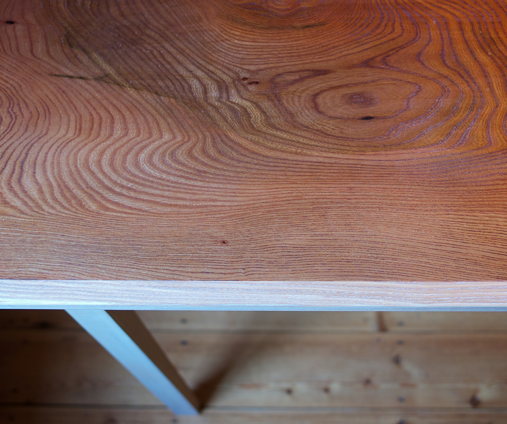 close up of handmade Petrel desk in english elm and ash