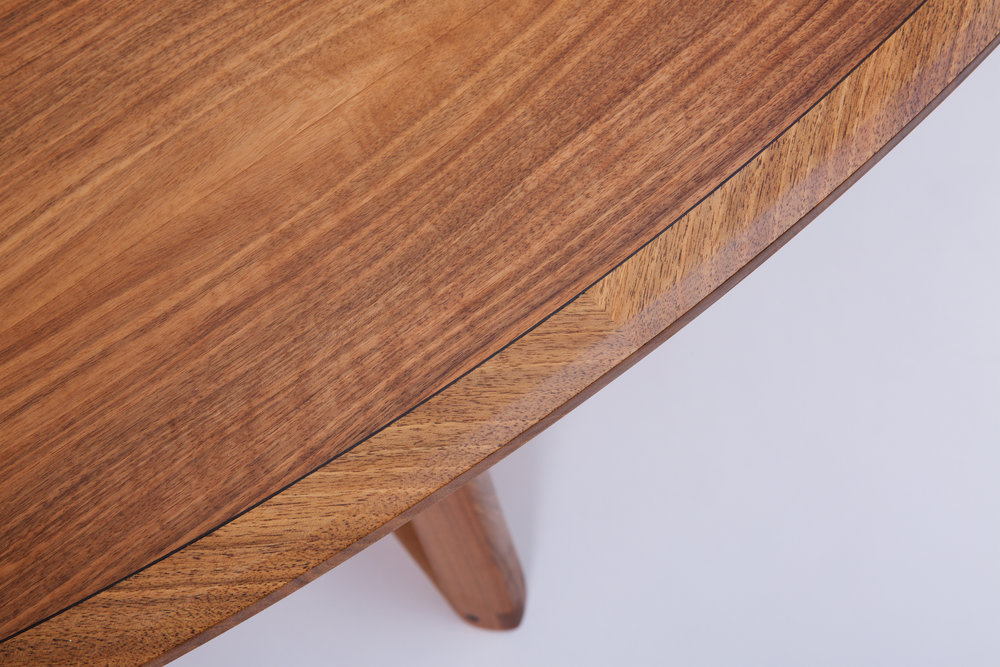 Petrel furniture ellipse dining table in English walnut top detail with bog oak line