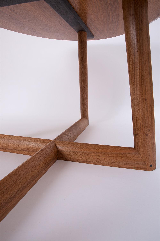 Petrel furniture ellipse dining table in English walnut leg detail