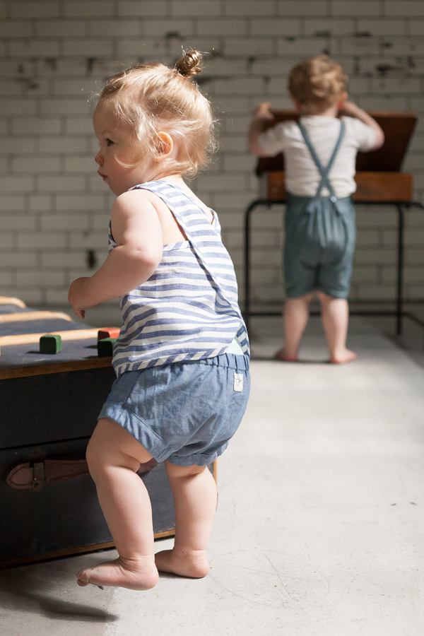 Model: Harla  willaby striped summer tank top with Billie Blooms chambray bloomers.  Model (back): Theo  willaby slub denim overalls with Lennon + Wolfe natural T shirt.