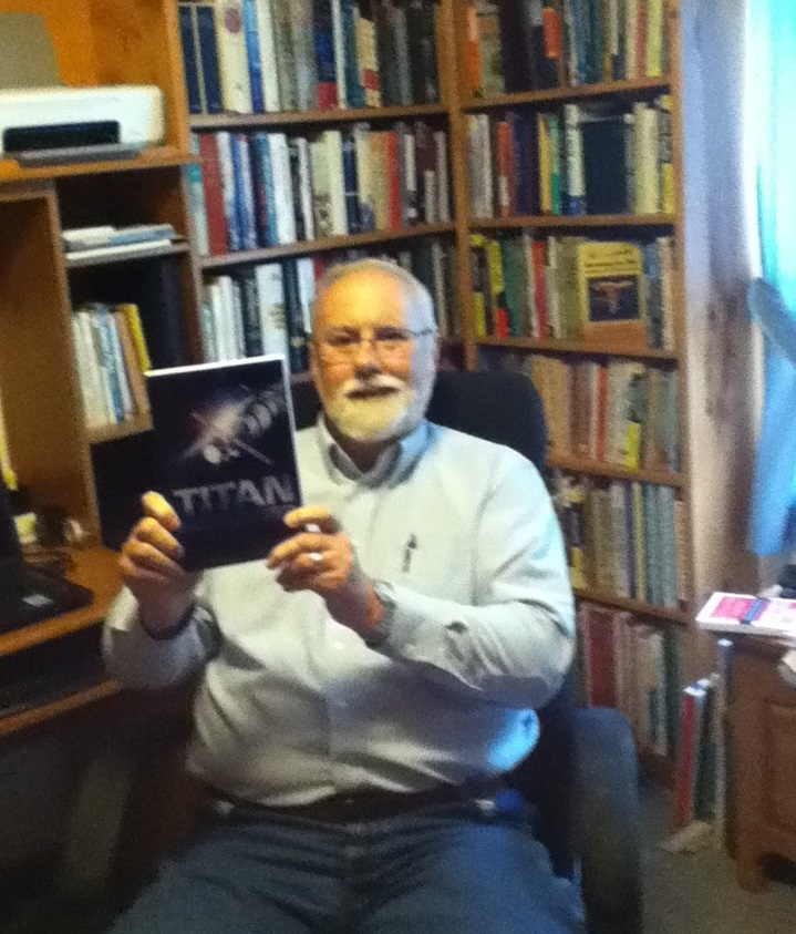 Kyle Pratt with the first copy of  Titan Encounter