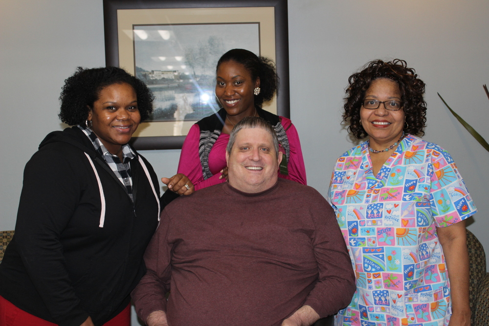 Mr. Ralph with Rehabilitation Program Director - Darlene Brown, Admissions and Marketing Director - Julia Sawney, and Registered Nurse - Shirley Baxter