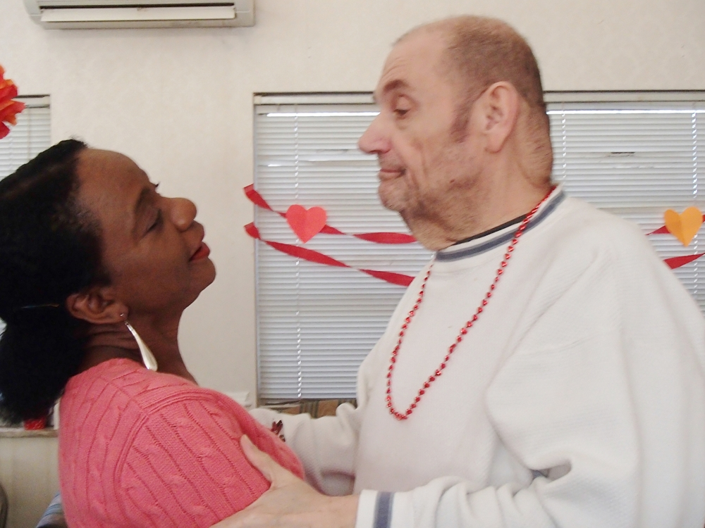 Dietary Director, Sonia Goddard, dances with our Valentine's Day king, Frank Padula.