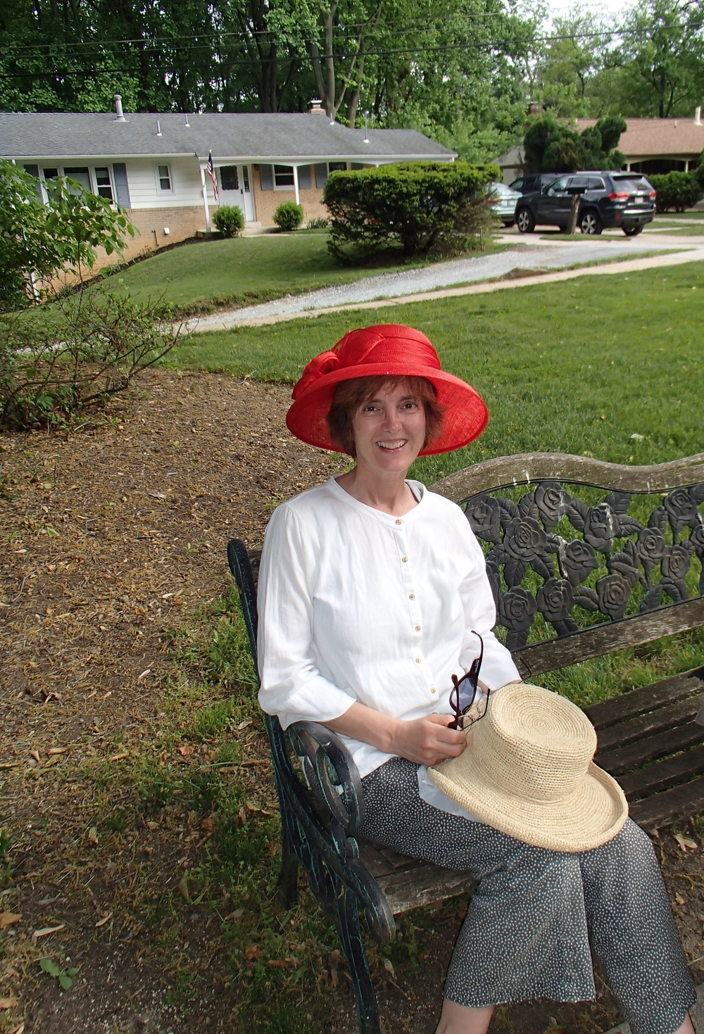 Mr. Goodwin's family member loved a staff member's red hat so much that she had to take a picture with it on