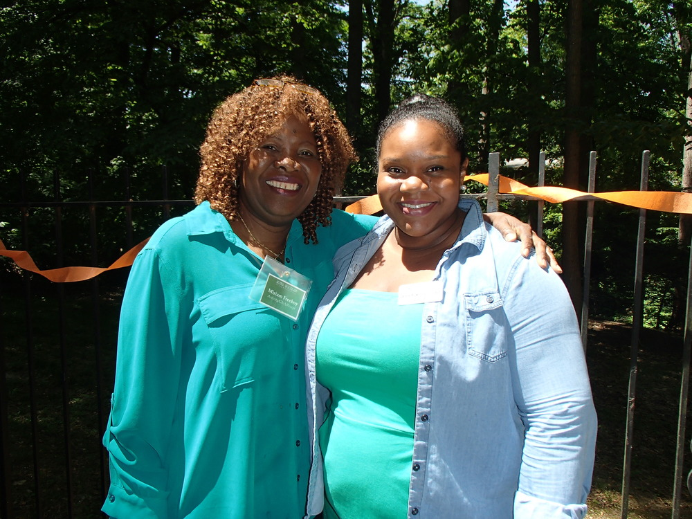 Mariam (Activities Assistant) and Darlene (Rehab Program Manager) in their green