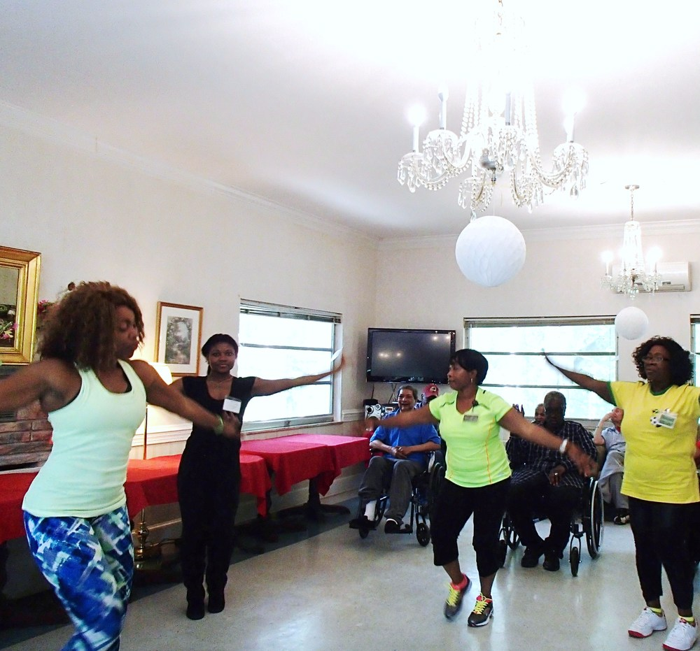 Ms. James showing residents and staff arm exercises
