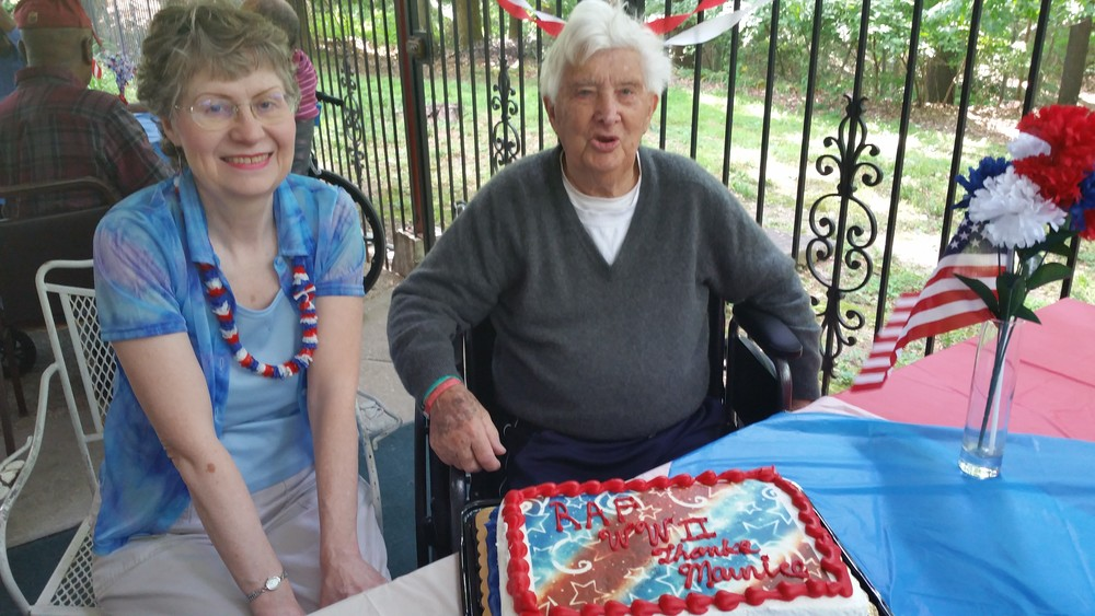Our World War II veteran is about to cut the cake with his good friend!