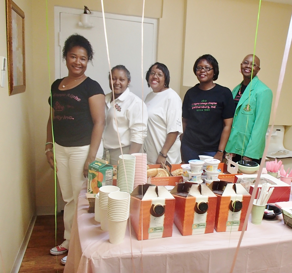 Ladies of AKA finished setting up the breakfast table