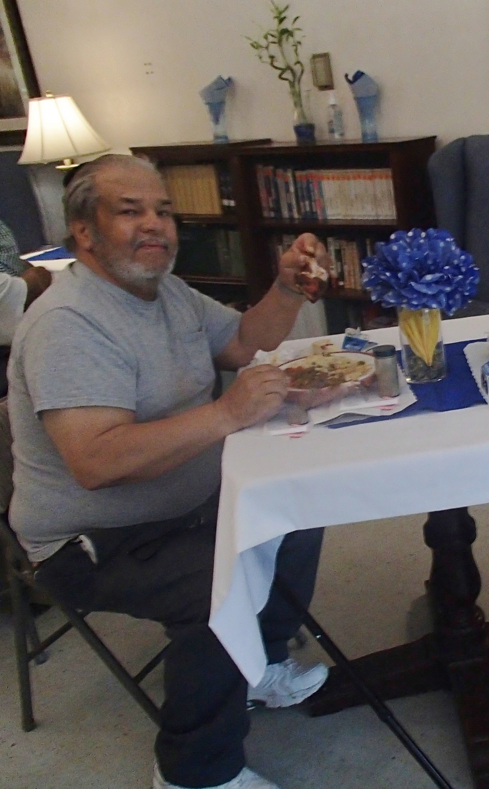 Mr. Norman Ridgeway is enjoying the special father's Day Meal.