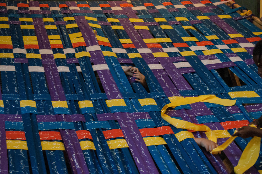 Little hands sticking through the tapestry help the fabric along. In this project, everyone made a valuable contribution!