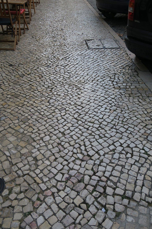 Cobblestone sidewalk Lisbon Portugal pilgrimage