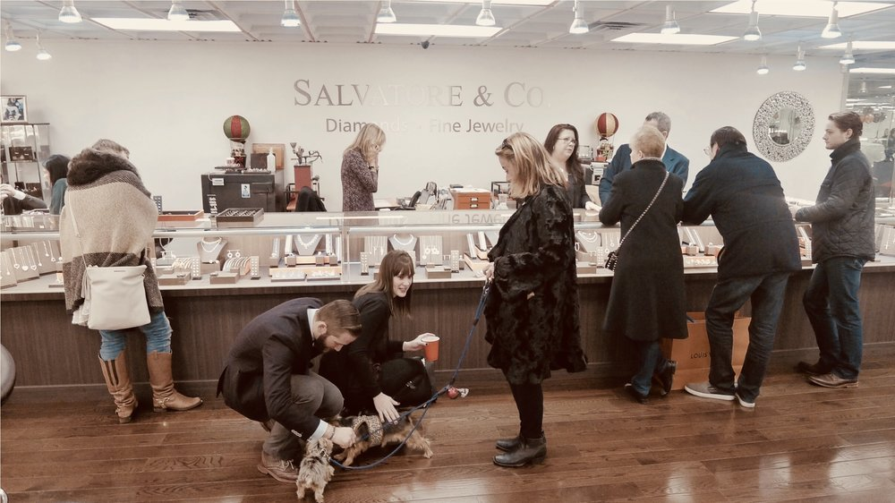 customers play with a dog at Salvatore and Co