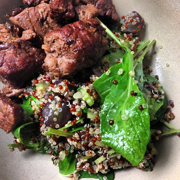 Quinoa, lemon, grapes, celery, arugula, white balsamic; grilled beef spiced w/berbere #staffmeal #glutenfree #quinoa #soupmama #healthyeats #food #salad #hungrygames