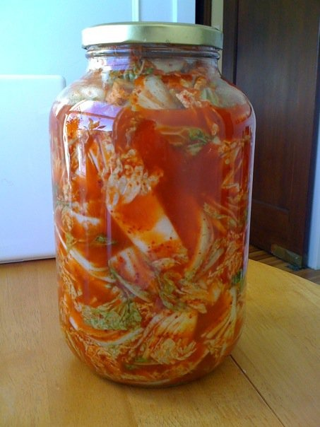 FERMENTATION: the start of last season's batch of kimchee: napa cabbage, fish sauce, gochugaru chili powder, onion, pear, garlic, ginger, daikon radish, sugar, sea salt, empty costco size pickle jar. It's almost gone.  Time to make a new batch!
